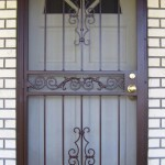 Brown Security Door With Scroll Center Panel