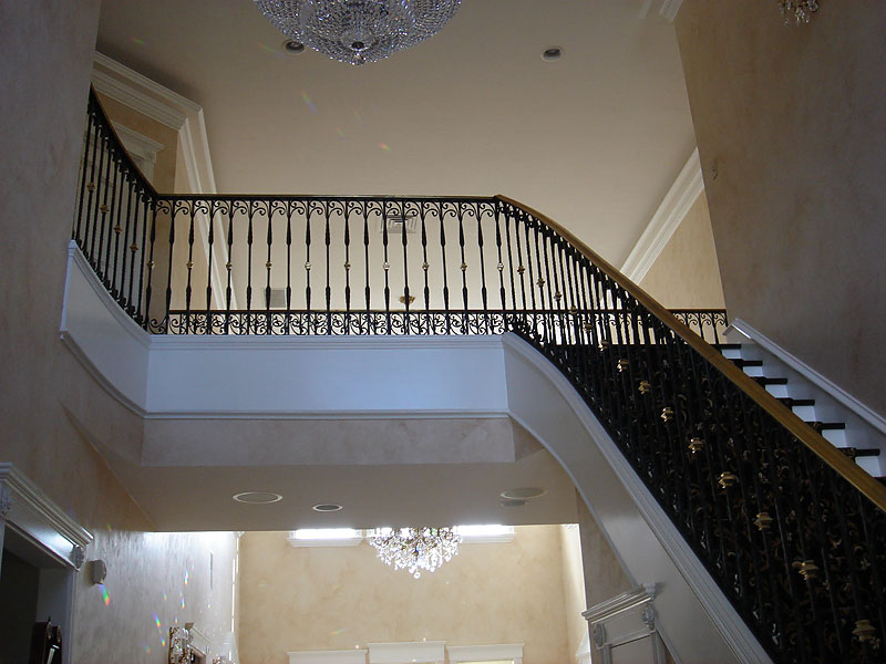 Forged Picket Railing With Brass Handrail And Collars