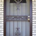 Brown Security Door With Scroll Center Panel