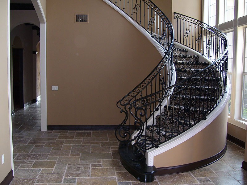 Curved Stair Railing With Forged